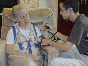 Taking blood pressure on senior adult.